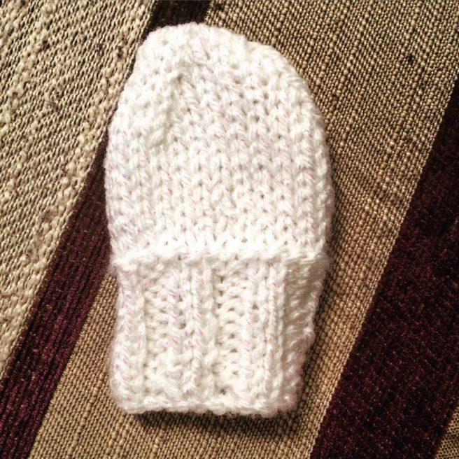 hand knitted baby mitten