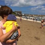babies first visit to the beach seaside