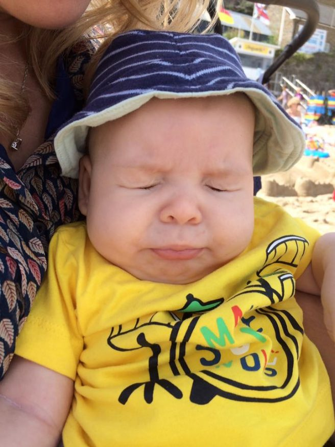 Sneezing Baby on the Beach