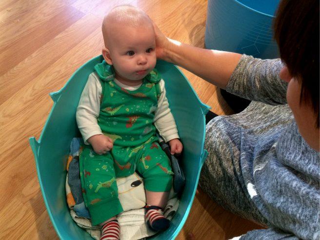 Baby in washing basket