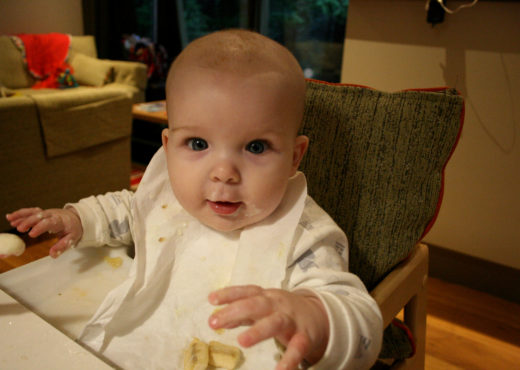 Baby eating breakfast baby led weaning