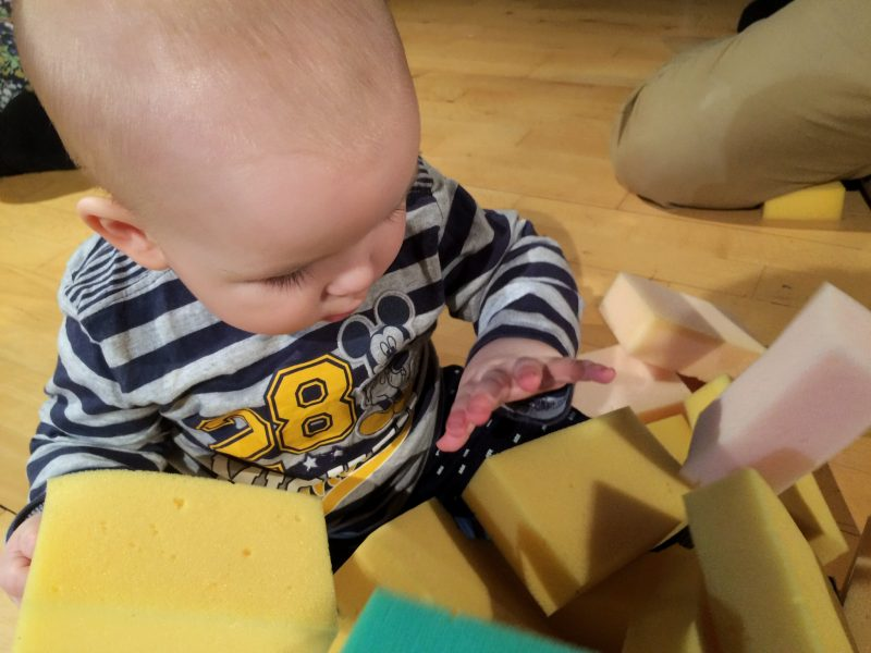 Baby playing with sponges