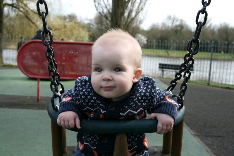 Pickle on the swing as a baby