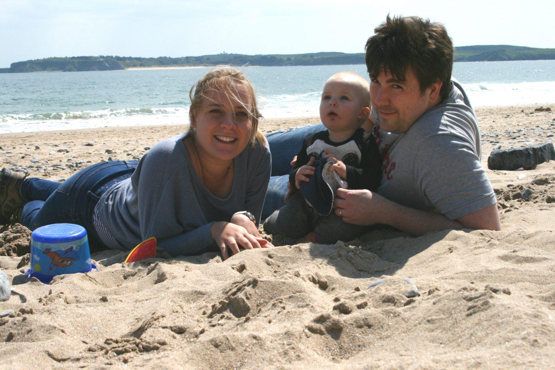 Family shot at Tenby beach Bluestone Wales