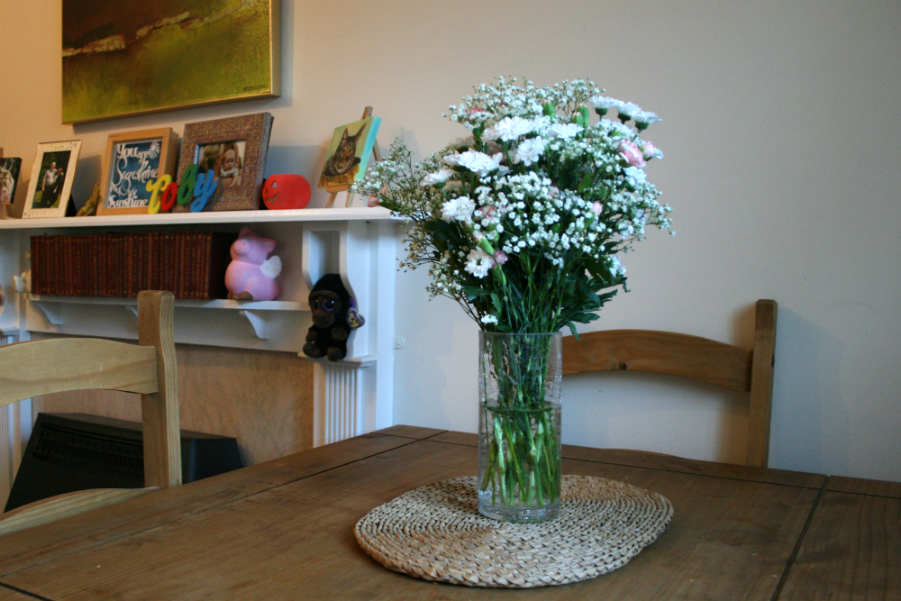 A Tidy Lounge with Dining Table Flowers