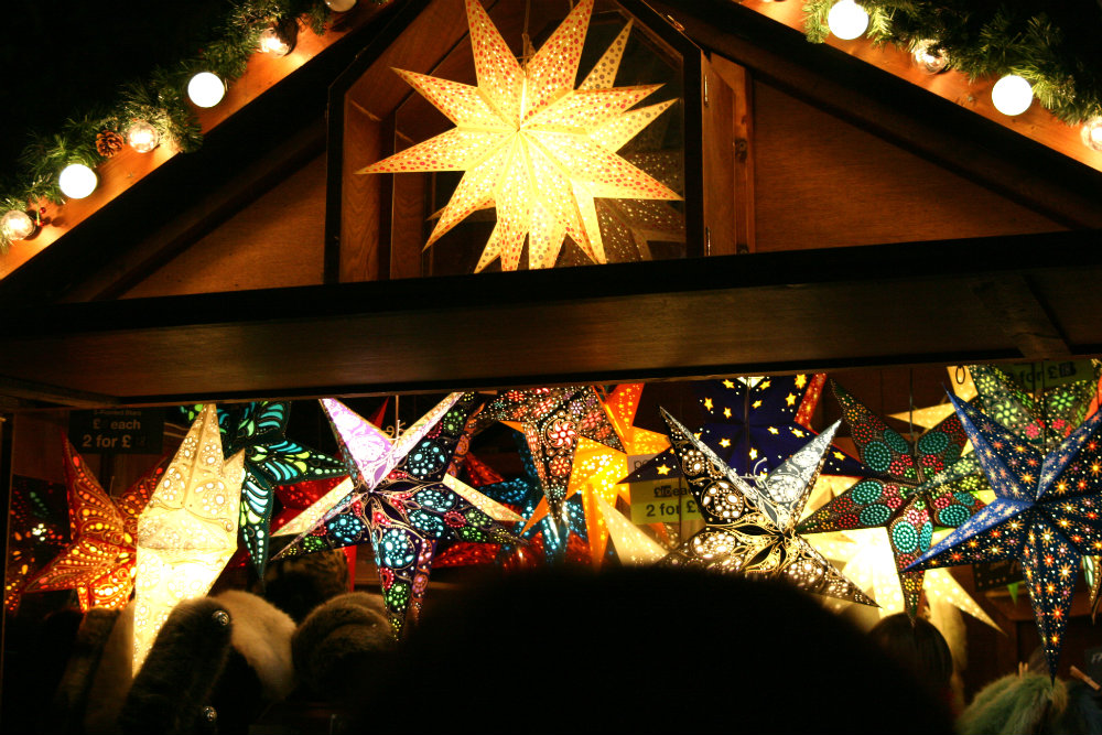 German Christmas Market stand with lots of beautiful star lights