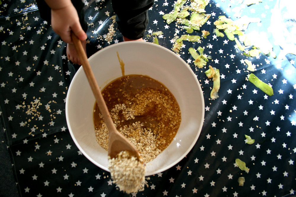 A Bowl on a Messy Me Mat with Oats and Syrup