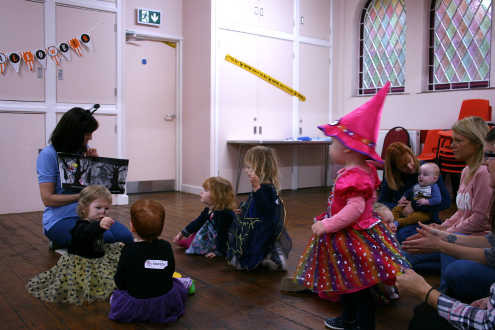 Talking Tots class with Toddlers dressed in Halloween costumes