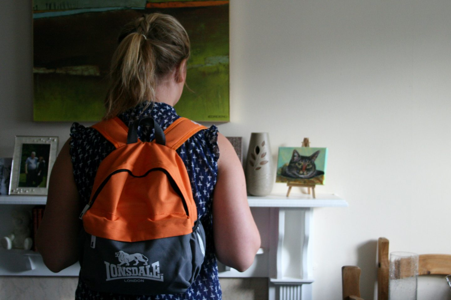 Photo of LPM wearing mini rucksack from behind