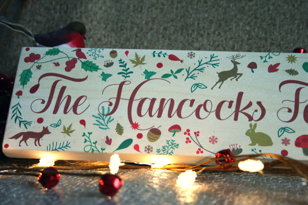 Personalised Christmas wooden sign saying The Hancocks Family Believe