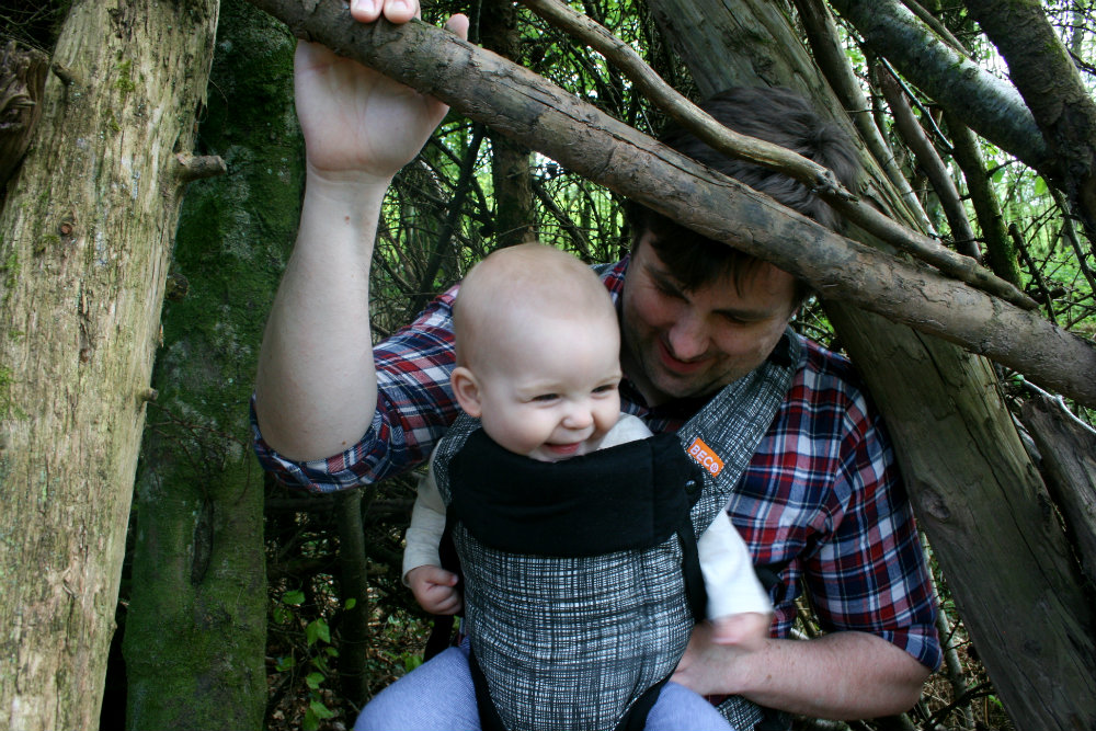 Baby in Beco Gemini Carrier laughing with Daddy at Bluestone