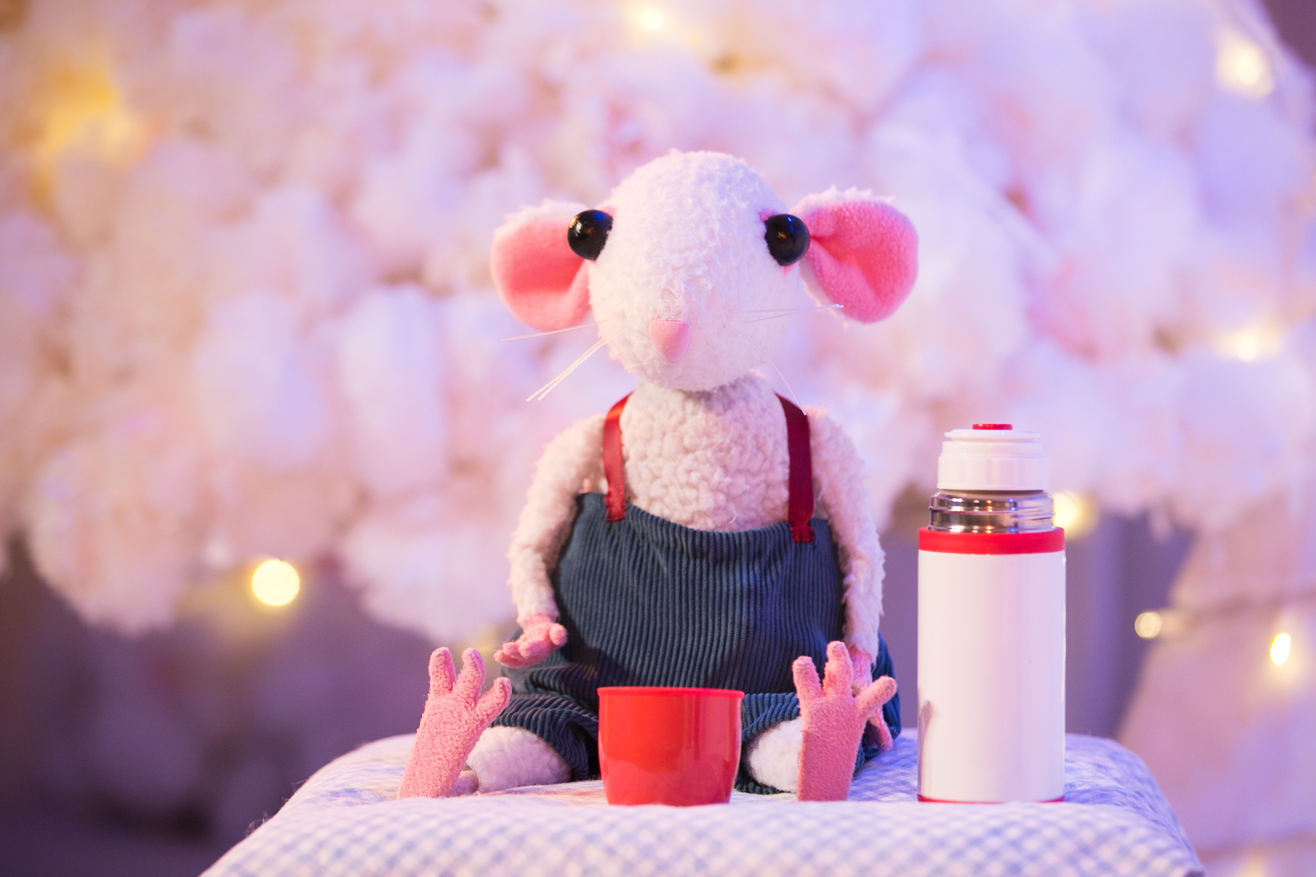 Snow Mouse sat drinking with a thermos