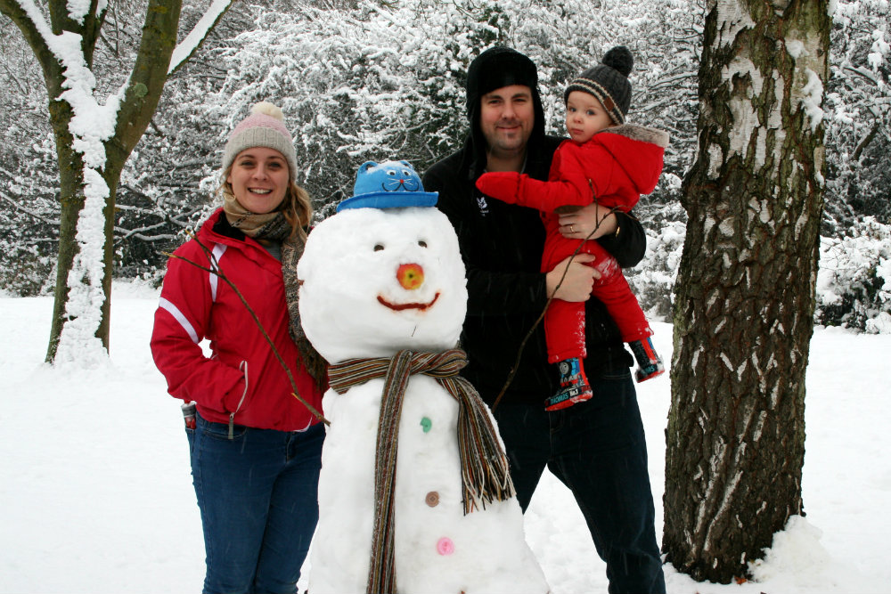 Family photo by our handbuilt Snowman