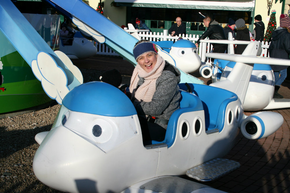 Surprised facial expression sat in the Jeremy Jet's Flying Academy ride