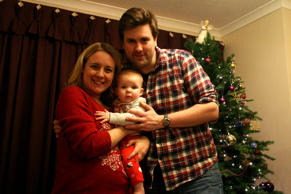 Christmas Family Portrait wearing the most unflattering red snowflake jumper ever