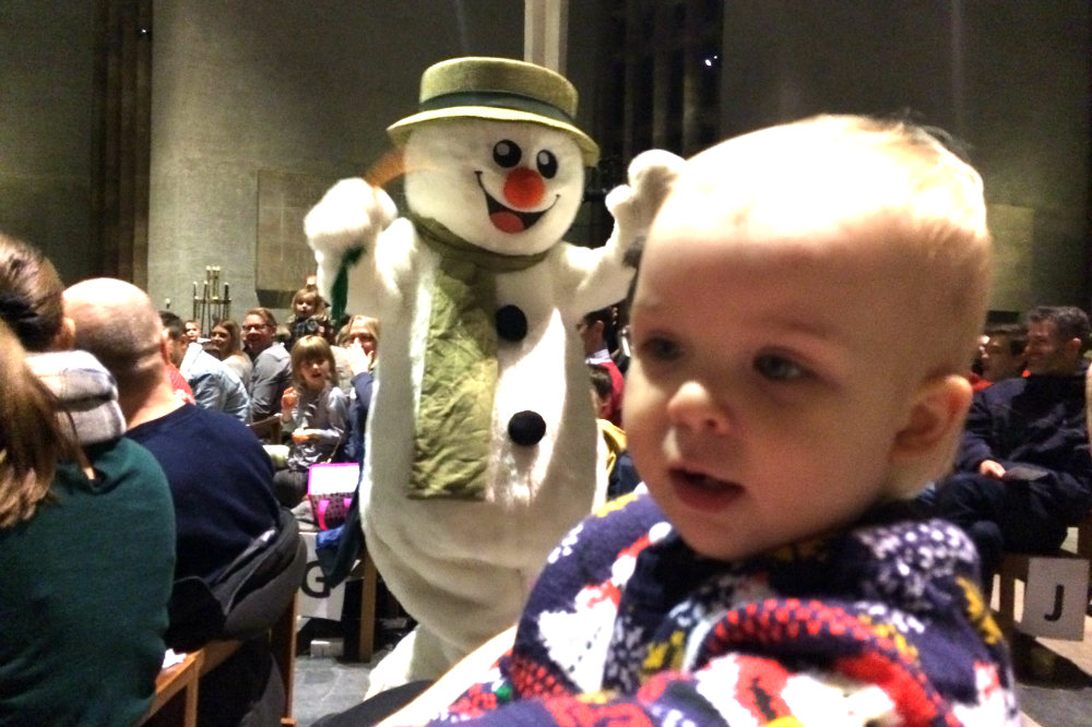 The Snowman came out to say hello at Coventry Cathedral - Pickle looks a bit bemused