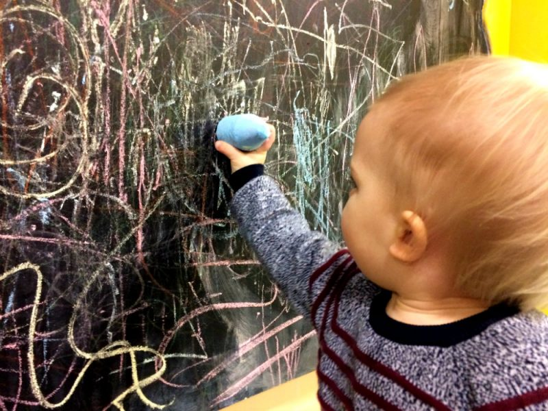 Drawing with Chalk on a massive chalkboard at 360 Play Redditch