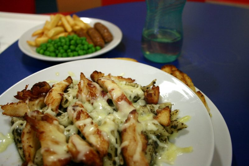 Chicken and Pesto Pasta with cheese and kids sausage and chips