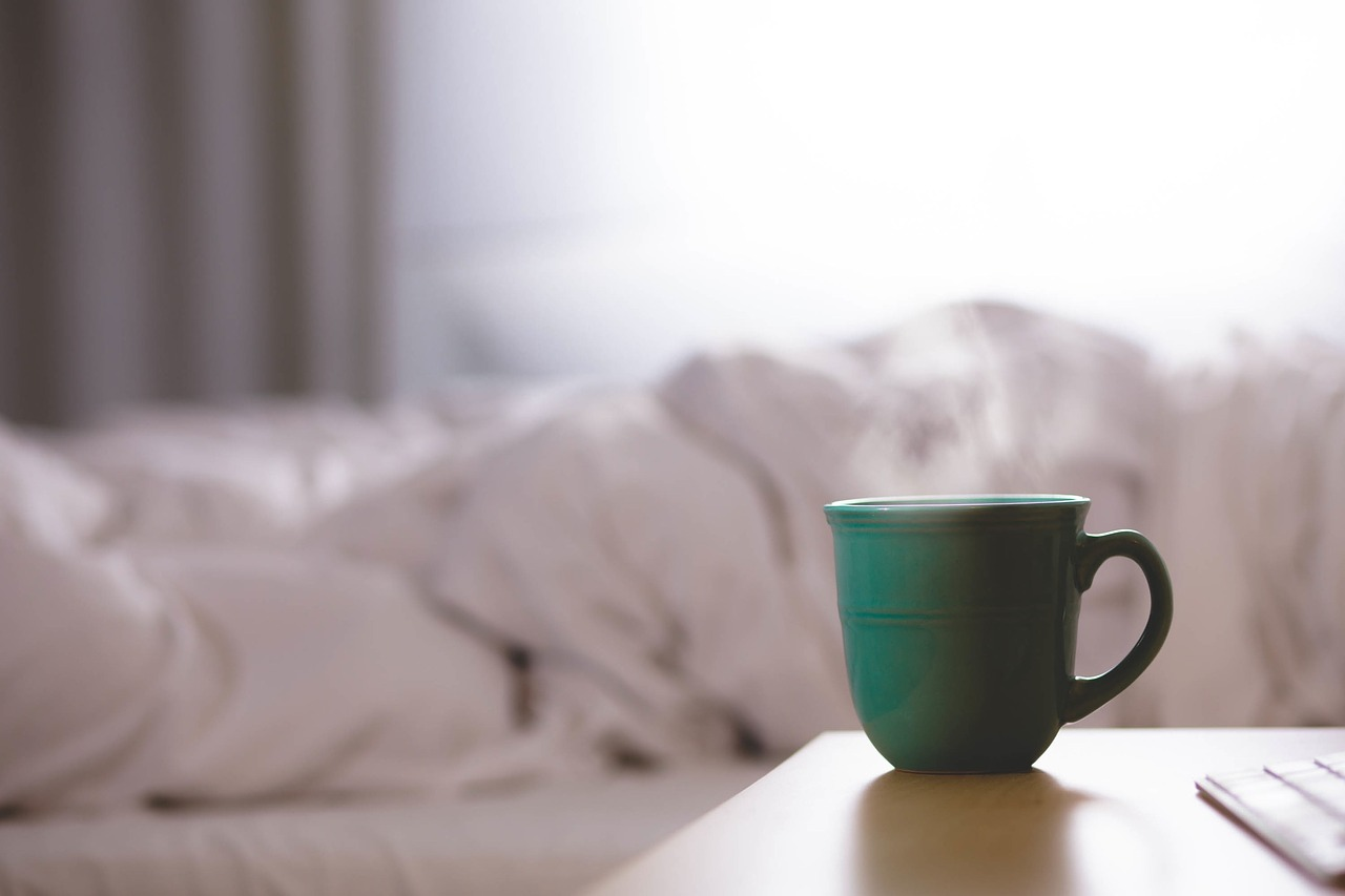 Cup of coffee by bed in the morning