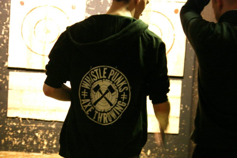 Kyle our instructor at Whistle Punks, from behind with a branded hoody