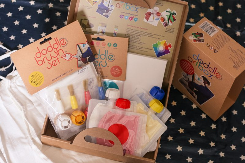 The full DoddleArt box with paints, brushes, canvas, stickers and apron