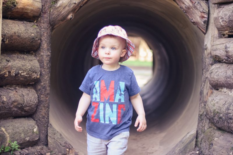 Pickle wearing an AMAZING t-shirt coming out of a tunnel