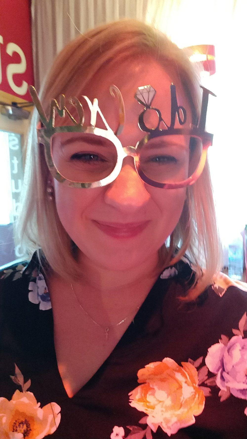 On the hen do, wearing I do Crew glasses