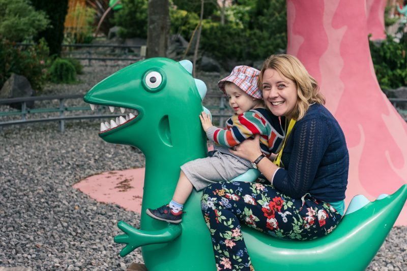 Mommy and Pickle having fun on the Dinosaur Ride at Peppa Pig World