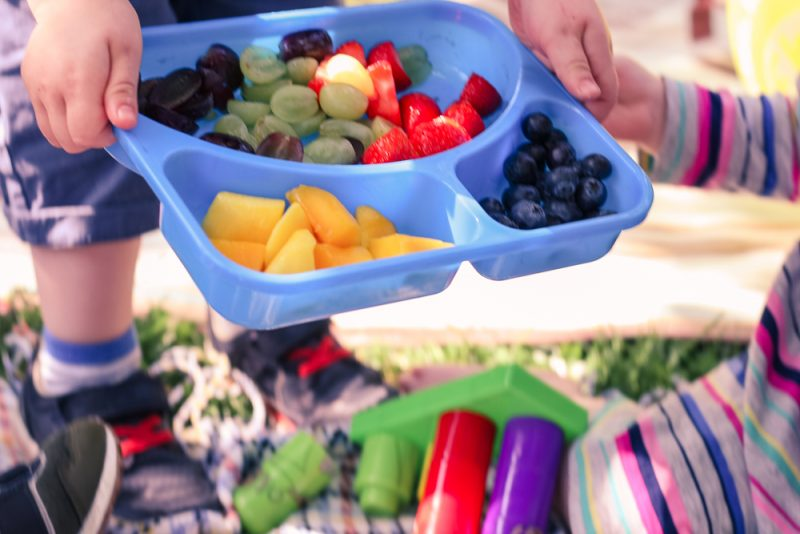 Leftover fruit in a tupperware - toddlers sharing food