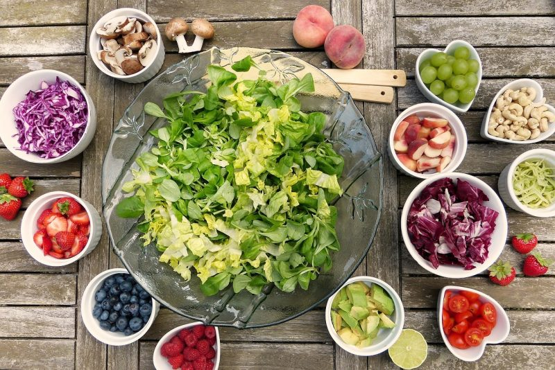 Bowl of salad and fruit outside on a picnic table - free slimming world food