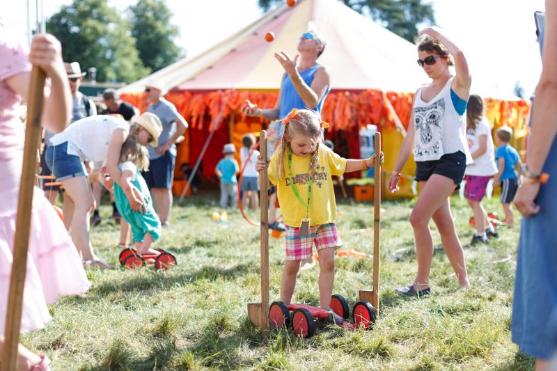 Cornbury Festival with child on stilts