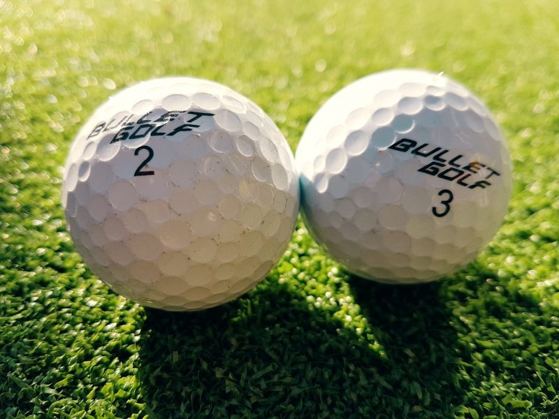 Two golf balls - a good date idea for the outdoors