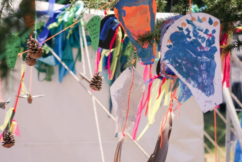 Children's artwork blowing in the wind at Cornbury Festival