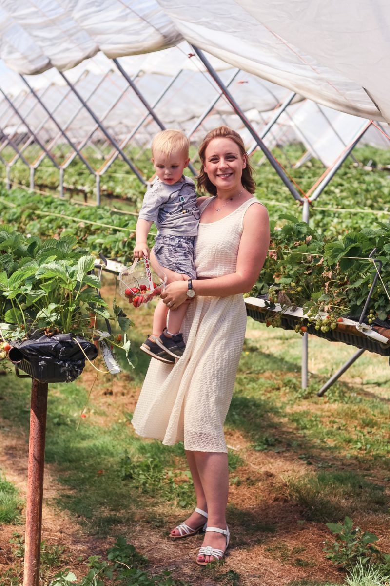 Mommy wearing the Evelyn dress from Elvi Clothing whilst strawberry picking