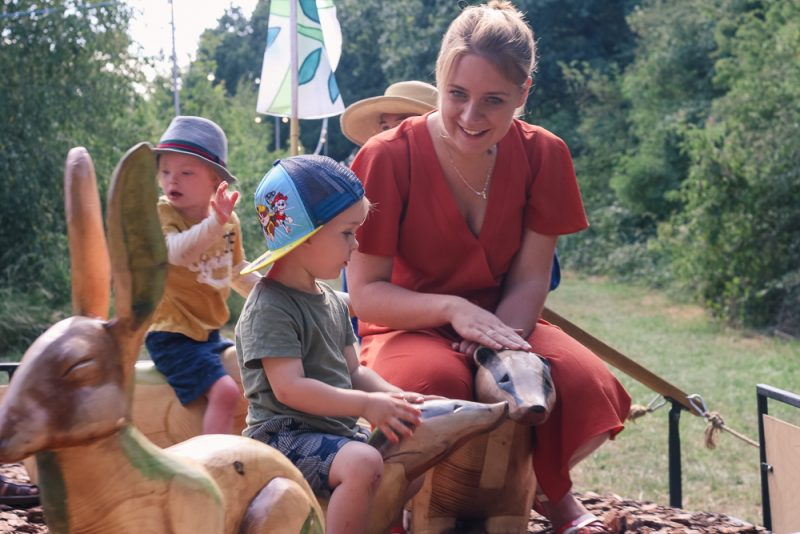 The Bewonderment Machine at Timber Festival - Mommy and Pickle sat on badgers