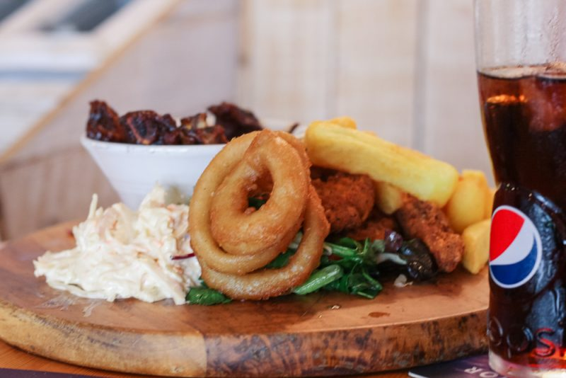 Ribs dish with chips, onion rings and coleslaw
