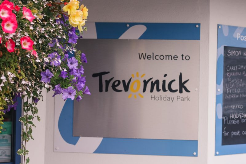 The reception entrance with flowers at Trevornick Cornwall