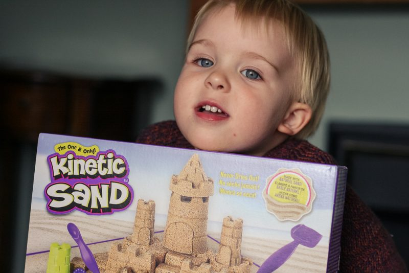 Pickle peering over his Kinetic Sand Beach Kingdom kit