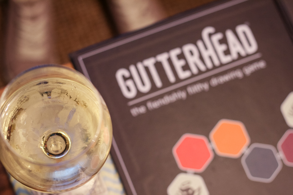 Gutterhead board game, with a glass of wine