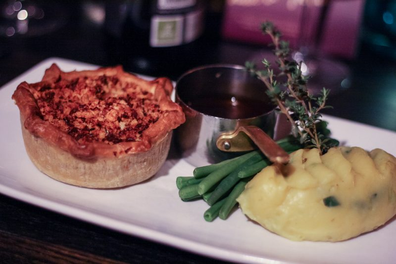Chicken and Leek Pie with ham hock crumb, mash and green beans