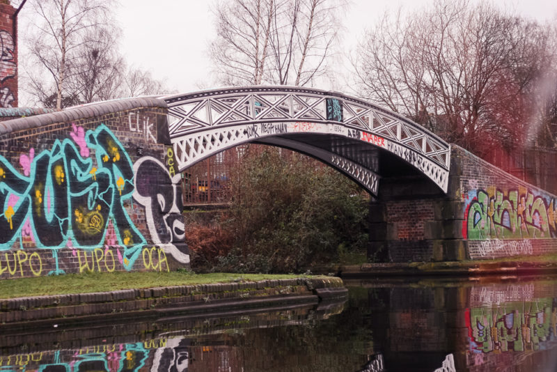 A graffiti covered bridge on the canal cruise from Brindley Place