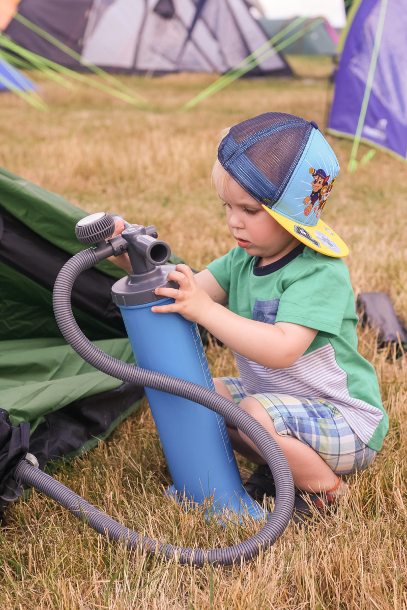 Pickle trying to help with the manual air pump for Kampa Paloma Air 5 tent