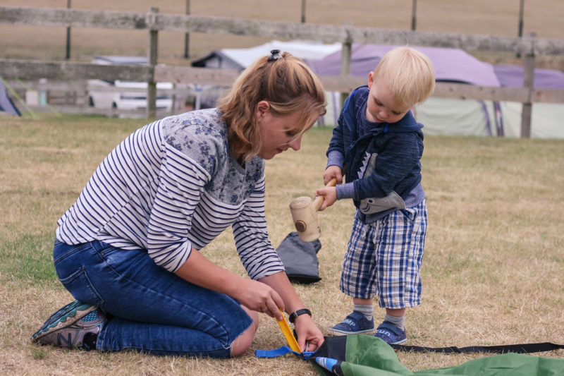 Pickle helping Mommy pitch the tent