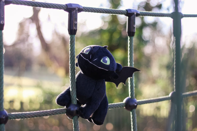 Toothless playing on some playground equipment
