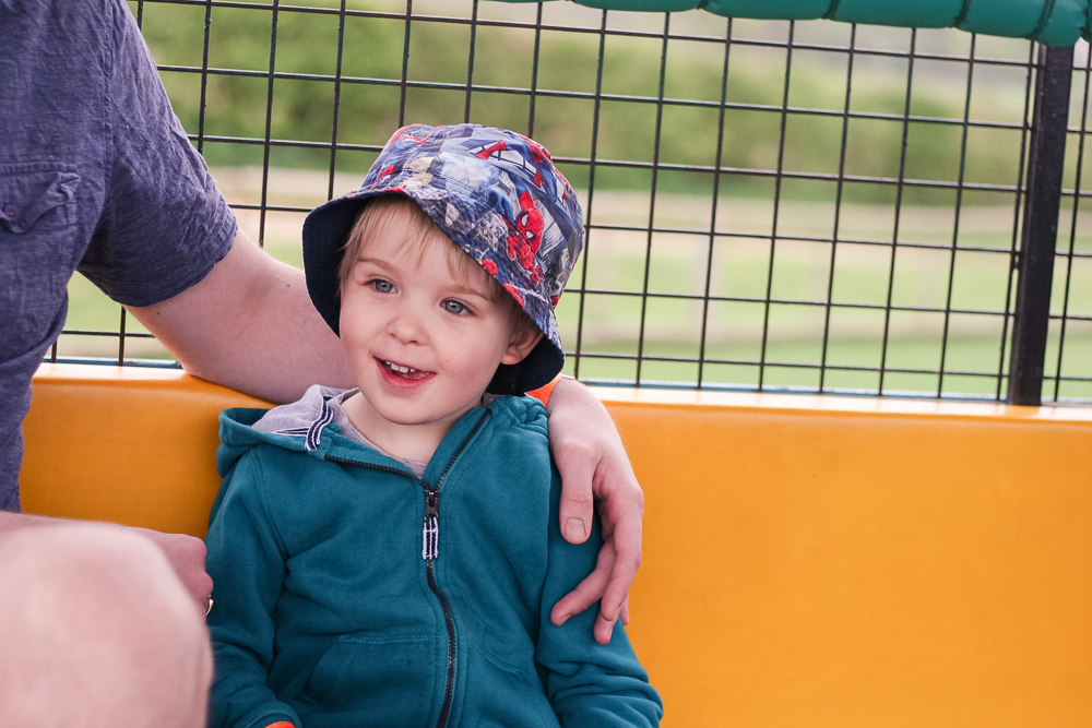 Daddy giving Pickle a cuddle on the Tractor Safari