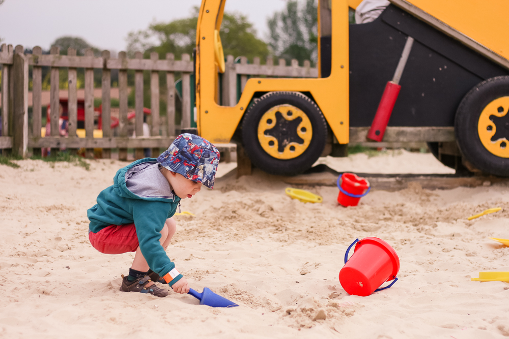 Playing in the sand pit.