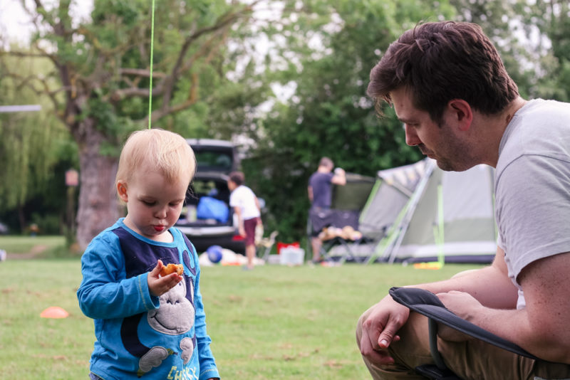 Pickle and Jim playing outside the tent at Hogsdown Farm