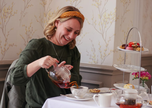 Laughing at tea pouring during afternoon tea