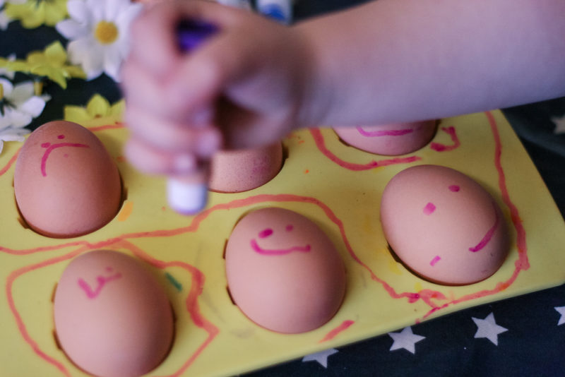 Smiley faces painted on eggs for Easter craft fun