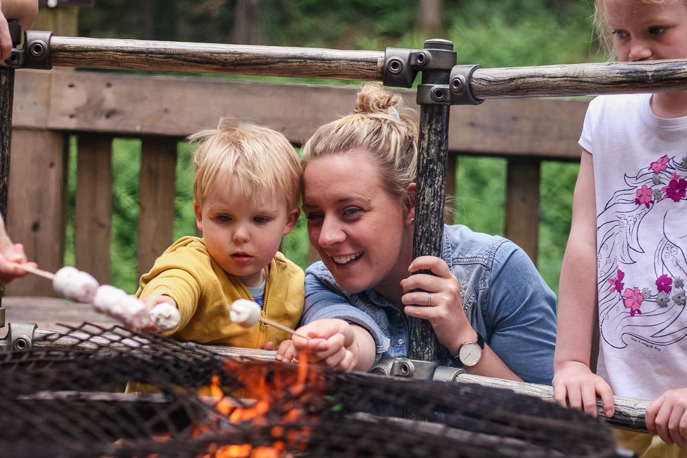 Holly and Pickle toasting marshmallows at Camp Smokey